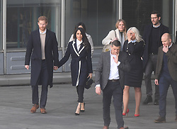 Prince Harry and Meghan Markle (left) leave after a visit to Millennium Point in Birmingham, as part of the latest leg in the regional tours the couple are undertaking in the run-up to their May wedding.