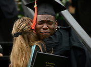 Cameron Bryant tears up as he gets a hug from Dean of Faculty Regina Webster at The Ensworth School graduation ceremony on May 27, 2017 at the high school campus on Hwy. 100. More than 100 students received their diploma.