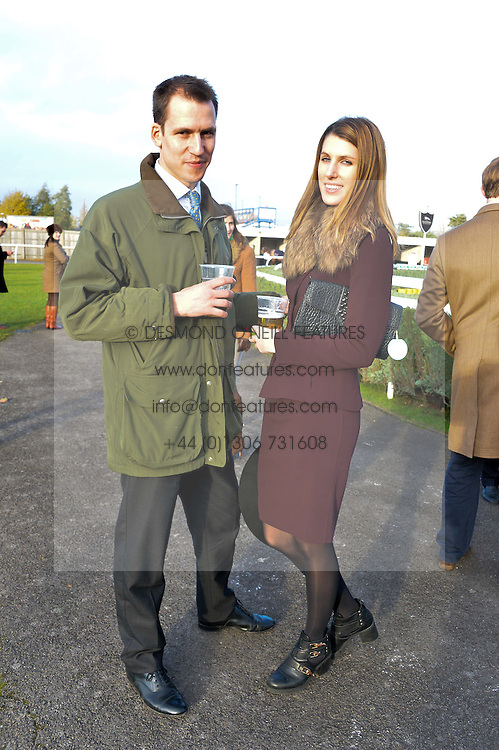 SUSANNA WARREN and BEN CHURCHILL  at the 2013 Hennessy Gold Cup at Newbury Racecourse, Berkshire on 30th November 2013.