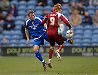 Photo: Paul Greenwood.<br />Burnley FC v Cardiff City. Coca Cola Championship. 09/04/2007.<br />Cardiff's Kevin McNaughton steals the ball from Steve Jones