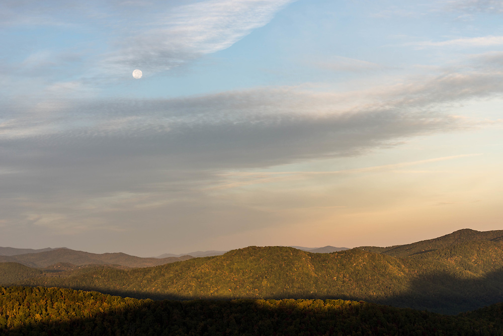 The full moon sets over the Linville Gorge in the early Fall of 2014.
