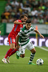August 15, 2017 - Lisbon, Portugal - Sporting's midfielder Marcos Acuna from Argentina vies with Steaua's midfielder Filipe Teixeira from Portugal (L) during the UEFA Champions League play-offs first leg football match between Sporting CP and FC Steaua Bucuresti at the Alvalade stadium in Lisbon, Portugal on August 15, 2017. (Credit Image: © Pedro Fiuza/NurPhoto via ZUMA Press)