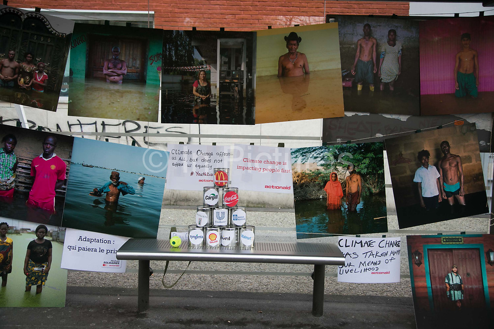 Drowning World pictures by Gideon Mendel on display, shown by Peuples Solidairs / Actionaid.  Citizen Climate Summit in Montreuil. A host of organisations, small NGOs, political art events and food stalls set the scene for discussions and debates on climate change as an alternative to the offical COP21 in Bourget.  The official climate talks in Paris is on and the pressure to come up with a sustainable legally binding is high. In the aftermath of recent terrorist attacks public demonstrations have been banned during the 2 weeks of climate talks