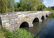 Stone bridge crossing River Avon chalk river at Amesbury, Wiltshire, England