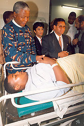 Nelson Mandela with patient in 1994.