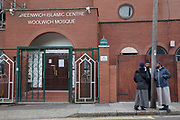 London, UK. Saturday 25th May 2013. Muslim men gather outside Greenwich Islamic Centre Woolwich Mosque. During Friday Prayers at Woolwich mosque, there was strong condemnation of Wednesday's killing of Drummer Lee Rigby. Worshippers were asked to say prayers for the soldier's family.