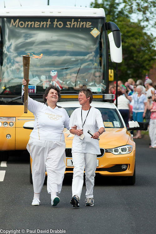 Olympic Torch reaches Sheffield Chapeltown/Ecclesfield/Parson  Cross leg.<br /> Yew Lane and blind Torch bearer number 111 Julie Smethurst who is blind heads for Parson Cross<br /> 25 June 2012.<br /> Image © Paul David Drabble