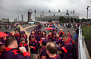 London 2012 Olympic Park in Stratford, East London. Large group of voluntees receive a pep talk prior to their shift.