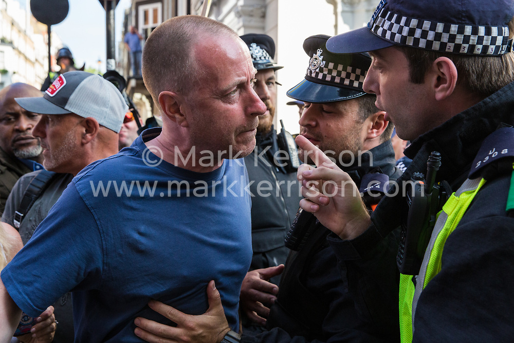 London, UK. 10th June, 2018. Police officers control a pro-Israel activist trying to block the pro-Palestinian Al Quds Day march through central London organised by the Islamic Human Rights Commission. An international event, it began in Iran in 1979. Quds is the Arabic name for Jerusalem.