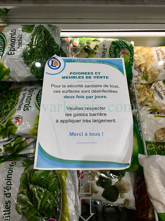 23 March 2020. Montreuil Sur Mer, Pas de Calais, France. <br /> Coronavirus - COVID-19 in Northern France.<br /> <br /> Coronavirus related signs indicating new cleaning procedures and reasons for closing certain facilities at Leclerc supermarket in Attin near the ancient citadel town of Montreuil Sur Mer.<br /> <br /> Numbers entering the store at any one time are restricted to try and maintain 'social distancing,' in an effort to halt the spread of the virus. Anyone leaving their home must carry with them an 'attestation,' in a effect a self administered permit to allow them out of the house. If stopped by the police, one must produce a valid permit along with identification papers. Failure to do so is punishable with heavy fines. Movement in France has been heavily restricted by the government.<br /> <br /> Montreuil Sur Mer was the headquarters of the British Army under Field-Marshal Sir Douglas Haig from March 1916 to April 1919. Over 1,200 year old, the ancient fortified  town with its high ramparts has endured through history, surviving the plague and King Henry VIII's invasion of France in 1544 when the Duke of Norfolk under Henry VIII's command laid a disastrous siege to the town which held firm until Norfolk was forced to withdraw in 1545. Residents are confident the ancient town can survive the coronavirus too. <br /> Photo©; Charlie Varley/varleypix.com