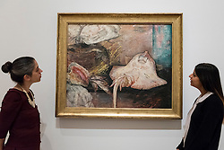"""© Licensed to London News Pictures. 25/10/2016. London, UK.  Staff members view """"The Skate, 1892"""" at the preview of Intrigue: James Ensor by Luc Tuymans.  Curated by fellow Belgian artist Luc Tuymans, this is the first exhibition of work by modernist artist James Ensor (1860-1949) to be held in the UK in twenty years and will run 29 October 2016 to 29 January 2017. Photo credit : Stephen Chung/LNP"""