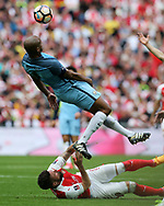 Vincent Kompany of Manchester city falls over Olivier Giroud of Arsenal. The Emirates FA Cup semi-final match, Arsenal v Manchester city at Wembley Stadium in London on Sunday 23rd April 2017.<br /> pic by Andrew Orchard,  Andrew Orchard sports photography.