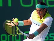 GASTON DE CARDENAS / EL NUEVO HERALD -- Apr. 2, 2009; Key Biscayne, FL, USA: Rafael Nadal of SpainJreturns a volley during his match against uan Martin Del Potro (ARG) at the Sony Ericsson tennis tournament in Key Biscayne, Florida April 2, 2009