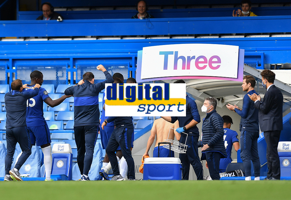 Football - 2019 / 2020 Premier League - Chelsea vs. Wolverhampton Wanderers<br /> <br /> Chelsea Manager Frank Lampard (back to camera) punches the air as they secure Champions League football for next season with a 2-0 defeat of Wolverhampton Wanderers, at Stamford Bridge.<br /> <br /> COLORSPORT/ASHLEY WESTERN