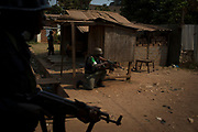 African Union (AU) peacekeeping soldiers take position after hearing repeated gun shots in a street of the capital Bangui January 19, 2014.