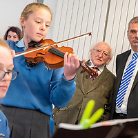 President Higgins and Principal Fergal McCarthy listen to music by pupils Eva Crowley and Ellen Crowley during the Presidents visit to Kinsale Community School.<br /> Picture. John Allen