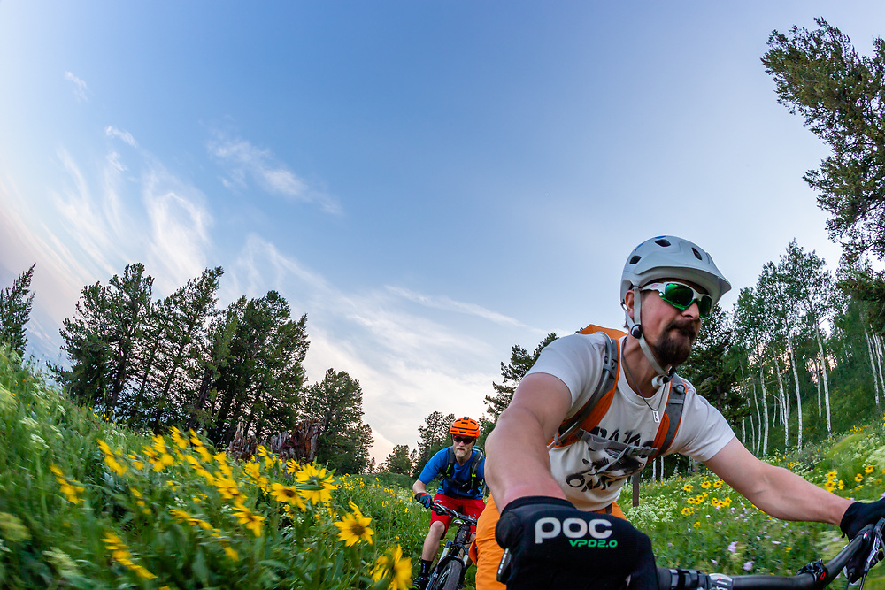 Jay Goodrich and Andrew Whiteford ride through the spring green of the Philip's Ridge trail from a POV camera angle off of Teton Pass near Wilson, Wyoming.
