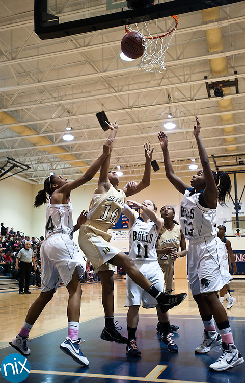 Concord's Mariah Black shoots against Hickory Ridge Tuesday night in Harrisburg. Concord won the game 65-34. (Photo by James Nix)