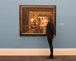 Sotheby's, London, January 28th 2016. A woman examines the detail of Le Miroir by Paul Delvaux, expected to fetch between £5 - 7.5 million, to be auctioned by Sotheby's in London as part of their sale of Impressionist, Modern, Surrealist and Contemporary art. ///FOR LICENCING CONTACT: paul@pauldaveycreative.co.uk TEL:+44 (0) 7966 016 296 or +44 (0) 20 8969 6875. ©2015 Paul R Davey. All rights reserved.