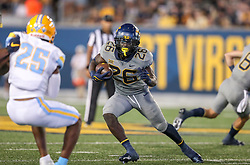 Sep 11, 2021; Morgantown, West Virginia, USA; West Virginia Mountaineers running back Justin Johnson Jr. (26) runs the ball during the fourth quarter against the Long Island Sharks at Mountaineer Field at Milan Puskar Stadium. Mandatory Credit: Ben Queen-USA TODAY Sports