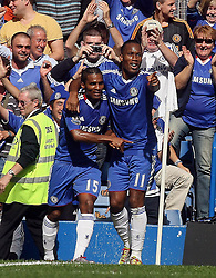 28.08.2010, Stamford Bridge, London, ENG, PL, Chelsea FC vs Stoke City, im Bild Florent Malouda of Chelsea  celebrates his goal with Didier Drogba, EXPA Pictures © 2010, PhotoCredit: EXPA/ IPS/ M. Pozzetti *** ATTENTION *** UK AND FRANCE OUT! / SPORTIDA PHOTO AGENCY