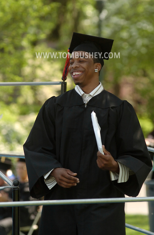Middletown, NY - A graduate smiles after receiving his diploma during the 58th commencement at Orange County Community College on May 17, 2008.