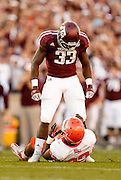 Nov 17, 2012; College Station, TX, USA;  Texas A&M Aggies running back Christine Michael (33) taunts Sam Houston State Bearkats defensive back Kenneth Jenkins (32) during the first half at Kyle Field. Michael would be ejected on the play. Mandatory Credit: Thomas Campbell-US PRESSWIRE