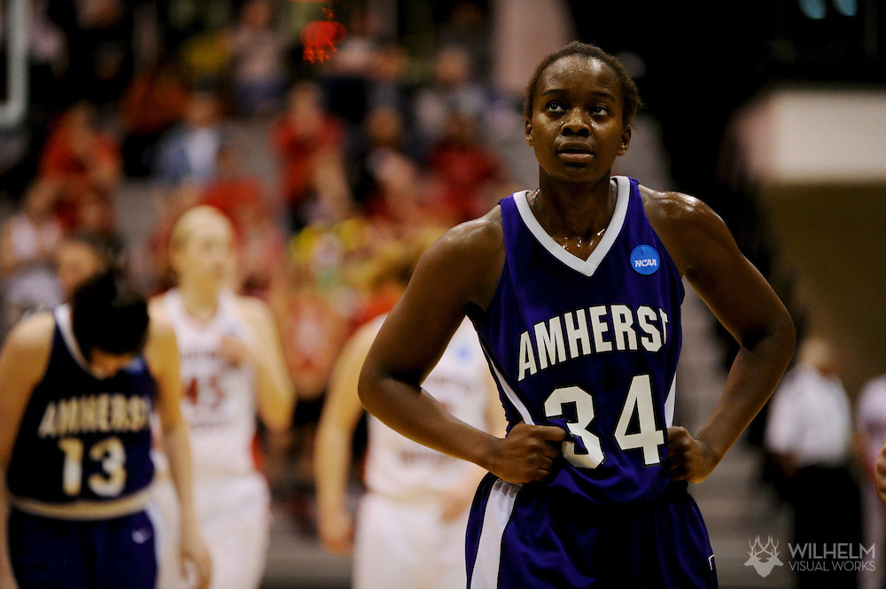 19 MAR 2011:  Atanga McCormick (34) of Amherst College checks the game states during a break in play against Washington University - St. Louisduring the 2011 NCAA Women's Division III Basketball Championship held at the Shirk Center on the campus of the Illinois Wesleyan University in Bloomington, IL. Amherst defeated Washington - St. Louis 64-55 to win the national title. © Brett Wilhelm