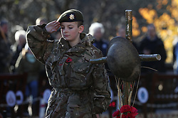 Scots Guards Army Cadet Force member Nathan Skinner, 13, salutes in memory of those who have fallen in conflict, following a service of Remembrance at the Edinburgh Garden of Remembrance in East Princes Street Gardens, Edinburgh.