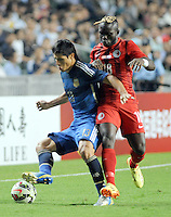 Facundo Roncaglia of Argentina, left, challenges Godfred Karikari of Hong Kong during a friendly football match in Hong Kong, China, 14 October 2014.<br /> <br /> Lionel Messi needed just six minutes to make his mark in Argentina's 7-0 rout of Hong Kong in a friendly at Hong Kong Stadium on Tuesday (14 October 2014). The Barcelona star Messi scored twice after going on as a substitute for the last 30 minutes of the game to celebrate the 100th anniversary of the Hong Kong Football Association. Napoli striker Gonzalo Higuain and Benfica's Nicolas Gaitan also scored two goals each after Sevilla's Ever Banega had opened scoring in the 19th minute.