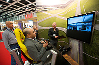DEU, Deutschland, Germany, Berlin, 02.10.2011:<br />Besucher einer Luftfahrt-Messe spielen mit einem Flugsimulator.