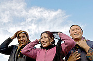 Three women from the village of Thiksey in Ladakh preparing for a portrait.
