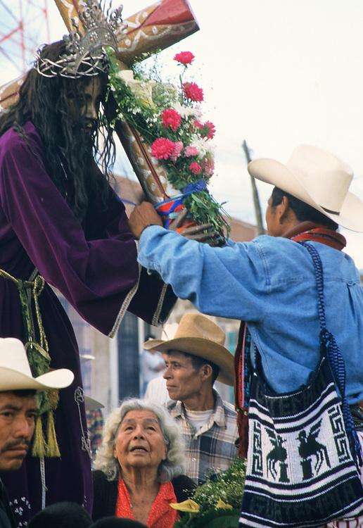 Guatemala, Santiago Atitlan. Jesus Christ on a Holy Week float (Easter).