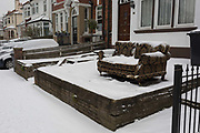 An unwanted sofa sits in the front of a house in a residential street during the bad weather covering every part of the UK and known as the Beast from the East because Siberian winds and very low temperatures have blown across western Europe from Russia, on 1st March 2018, in Lambeth, London, England.