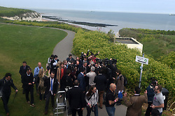 """© London News Pictures. """"Looking for Nigel"""". A body of work by photographer Mary Turner, studying UKIP leader Nigel Farage and his followers throughout the 2015 election campaign. PICTURE SHOWS - Nigel Farage is surrounded by media as he announces his resignation as leader of UKIP in a typically picturesque location, at the Botany Bay Hotel on the Broadstairs coast, on May 8th 2015. Mr Farage had always said that should he fail to become an MP in the constituency of south Thanet he woudl step down as leader. Within three days, however, Mr Farage was reinstated as leader after UKIP refused his resignation. . Photo credit: Mary Turner/LNP **PLEASE CALL TO ARRANGE FEE** **More images available on request**"""