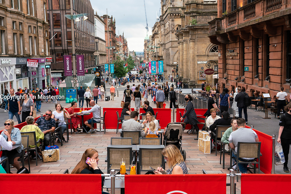 Glasgow, Scotland, UK. 10 July  2021.  Members of the public shopping and dining in outdoor cafes on Buchanan Street on a warm Saturday afternoon in Glasgow City centre.  The good weather brought many people into the city centre to take advantage of many cafes and bars that have set up outdoor seating areas  on the pavements on the city streets. Iain Masterton/Alamy Live news.