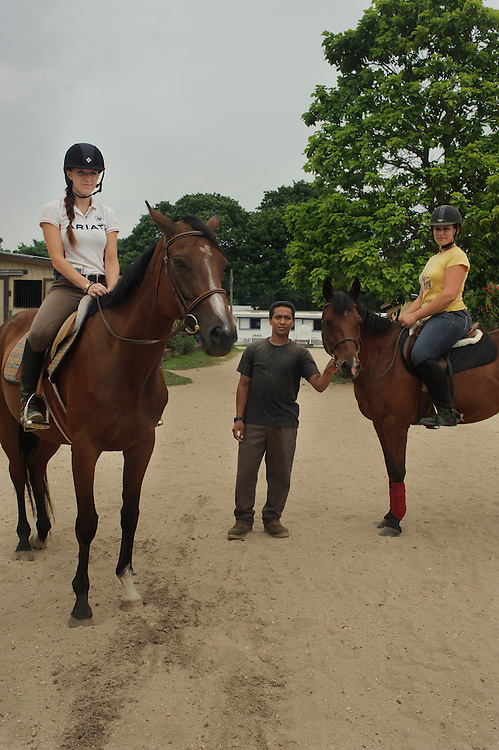 Caitltyn Reiners from Bay Shore with Jonah (8 year old horse), Nolberto Mendez from Honduras and Alexandra Perez, American-Puerto Rican with Doc (12 years old horse), pose for a photograph at Knoll Farm located in Brentwood.
