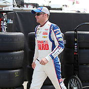 NASCAR Sprint Cup driver Dale Earnhardt Jr. (88)  scurries to his hauler in the garage area during the NASCAR Coke Zero 400 Sprint practice session at the Daytona International Speedway on Thursday, July 4, 2013 in Daytona Beach, Florida.  (AP Photo/Alex Menendez)