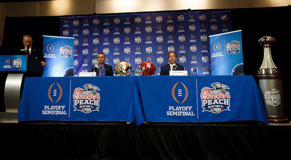 Washington Huskies head coach Chris Petersen and Alabama Crimson Tide head coach Nick Saban hold a press conference at the Hyatt Regency on December 30, 2016 in Atlanta. The Crimson Tide face the Huskies in the 2016 Chick-fil-A Peach Bowl Playoff Semifinal on New Year's Eve, with the winner advancing to the National Championship. (Jason Parkhurst / Abell Images for the Chick-fil-A Peach Bowl)