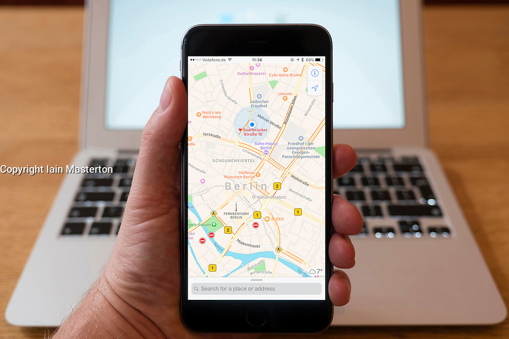 Using iPhone smartphone to display Apple Maps view of central Berlin