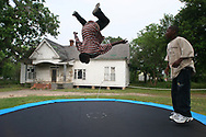 Mario Wright and his brother Marvin Wright play in their front yard.