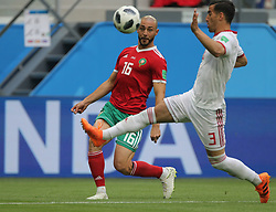 June 15, 2018 - Saint Petersburg, Russia - Noureddine Amrabat (L) of the Morocco national football team and Ehsan Hajisafi of the Iran national football team vie for the ball during the 2018 FIFA World Cup match, first stage - Group B between Morocco and Iran at Saint Petersburg Stadium on June 15, 2018 in St. Petersburg, Russia. (Credit Image: © Igor Russak/NurPhoto via ZUMA Press)
