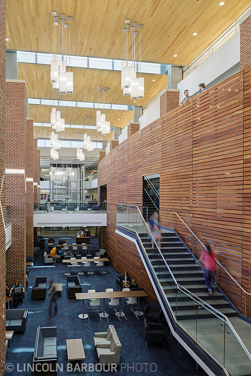 A view of a stairwell inside the Liberty Student Center and how it overlooks and interacts with the lobby below as students move through the space.
