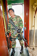 """Sept 26, 2009 -- PATTANI, THAILAND: A Thai soldier provides security on train in Pattani province in Thailand's deep south. The trains have been frequent targets of Muslim separatist insurgents. Thailand's three southern most provinces; Yala, Pattani and Narathiwat are often called """"restive"""" and a decades long Muslim insurgency has gained traction recently. Nearly 4,000 people have been killed since 2004. The three southern provinces are under emergency control and there are more than 60,000 Thai military, police and paramilitary militia forces trying to keep the peace battling insurgents who favor car bombs and assassination.  Photo by Jack Kurtz / ZUMA Press"""