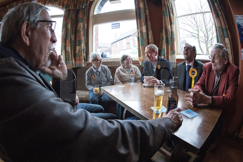 © Licensed to London News Pictures . 14/02/2017 . Stoke-on-Trent , UK . Lib Dem leader TIM FARRON with candidate DR ZULFIQAR ALI and party activists , at the Liberal Democrat by-election base in the Wheatsheaf Pub on Sheaf Street , campaigning in the Stoke Central by-election . Photo credit : Joel Goodman/LNP
