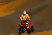 Riding Quad Bikes (All Terrain Cycle) in the Swakopmund Dunes, Swakopmund, Namib Desert, Namibia