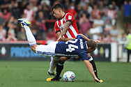 Brentford 's Nico Yennaris  fouls David Vaughan of Nottingham Forest (L). EFL Skybet football league championship match, Brentford  v Nottingham Forest at Griffin Park in London on Saturday 12th August 2017.<br /> pic by Steffan Bowen, Andrew Orchard sports photography.