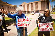 09 MAY 2011 - PHOENIX, AZ: People opposed to illegal immigration try to shout down immigrants' rights protesters at the Arizona State Capitol in Phoenix Monday. Governor Jan Brewer, State Senate President Russell Pearce and Attorney General Tom Horne, all Republicans, held one press conference to announce that the state was suing to take its legal battle over SB1070, Arizona's tough anti-immigration law, past the US Court of Appeals and straight to the US Supreme Court. State Senator Steve Gallardo, a Democrat, held a press conference to announce that he was opposed to the Republican's legal actions and called on them to drop the suit altogether. Isolated shouting matches broke out between activists on both sides of the immigration issue during the press conferences.       Photo by Jack Kurtz