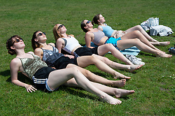 © Licensed to London News Pictures 08/06/2021. Greenwich, UK. Five friends sunbathing in Greenwich Park, London enjoying the hot sunny weather today. Photo credit:Grant Falvey/LNP