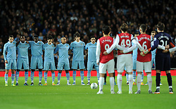 LONDON, ENGLAND - Tuesday, November 29, 2011:The two teams stand for a minute's silence in memory of Gary Speed during the football match of English Football League Cup, Quarter-Final, between FC Arsenal and Manchester City FC at Emirates Stadium, London, United Kingdom on 2011/11/29. EXPA Pictures © 2011, PhotoCredit: EXPA/ Sportida/ Chris Brunskill..***** ATTENTION - OUT OF ENG, GBR, UK *****